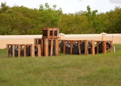 photo of sculpture Keel in heavy wooden containers