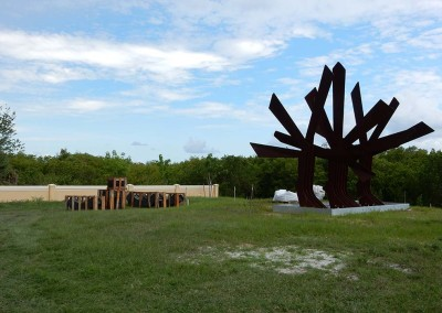 photo of sculpture Keel in heavy wooden containers with Steel palm in foreground